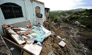 A partly destroyed house after a landslide in Vicoso Jardim shantytown in Niteroi