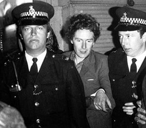 Malcolm McLaren: McLaren being led away by the police after his arrest, May 1977