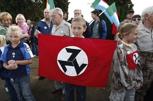 TerreBlanche: A young AWB supporter holds a flag with the party's insignia