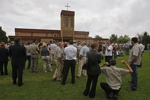 TerreBlanche: Supporters of Eugene Terre'Blanche stand outside the church