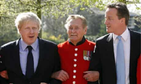 Boris Johnson and David Cameron pose with one of the Chelsea Pensioners on 9 April 2010.