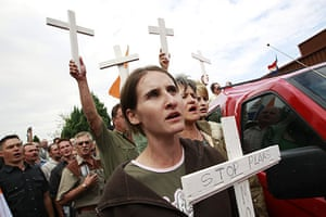 terreblanche update: People hold crosses during the funeral of Eugene Terre'Blanche