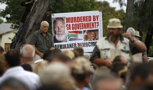 terreblanche update: People display a banner during the funeral of Terre'blanche