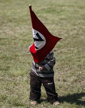 terreblanche update: A child waves a Afrikaner Resistance Movement (AWB) flag during the funeral