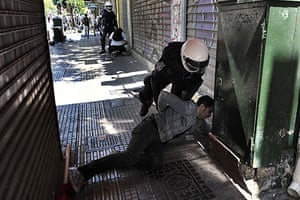 Athens Riot: A Greek police member detains a demonstrator during a May day protest