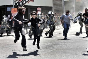Athens Riot: Demonstrators run away from riot police during a May Day protest in Athens
