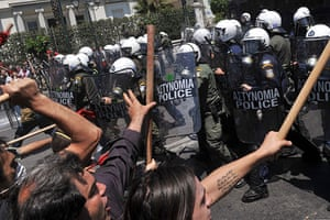 Athens Riot: Demonstrators clash with police outside the Greek Parliament
