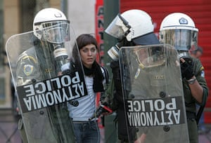 Athens Riot: Protesters clash with riot police during a demonstration in Athens on 1 May