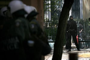 Athens Riot: A demonstrator outside the Polytechnic School during a protest in Athens