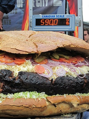 Big Food: A 590 pound hamburger is weighed at Yonge Dundas Square in Toronto