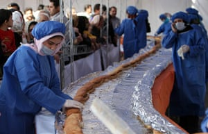 Big food: Workers prepare a giant ostrich meat sandwich in Iran
