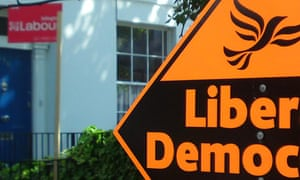 Signs supporting Labour and the Liberal Democrats in a garden in north London. Photograph: Paul Owen