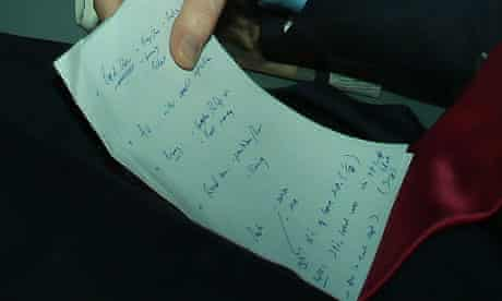 Nick Clegg holding notes on coalition negotiations.