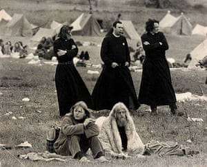 Glastonbury at 40: Three men dressed as priests walking in the Tent Field