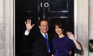 David and Samantha Cameron wave from 10 Downing Street after Mr Cameron became prime minister