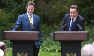 David Cameron looks embarassed after being reminded that he once called Nick Clegg a 'joke'