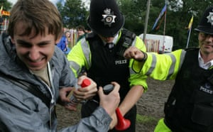 Glastonbury at 40: A festival goer is reprimanded by police at the Glastonbury festival