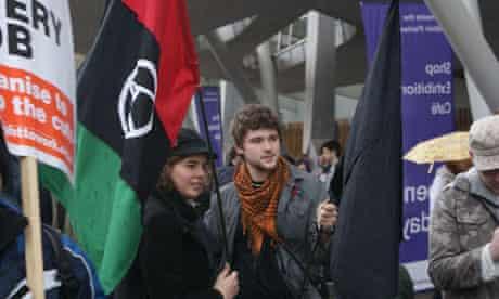 Cameron protest: Edinburgh protesters greet David Cameron at the Scottish Parliament