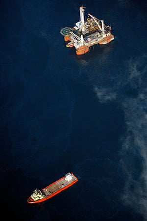 Deepwater Horizon: Gulf Oil Spill Begins To Reach Land: barge carries oil containment vessel