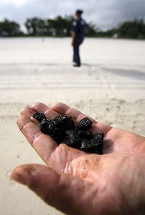 Deepwater Horizon: Gulf Oil Spill Begins To Reach Land: tar balls, Pass Christian, Mississippi