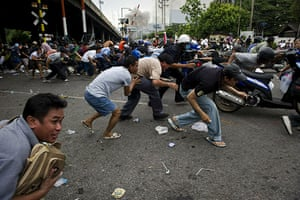 bangkok violence: Redshirts take cover as soldiers open fire