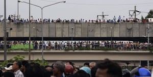bangkok violence: Locals crowd on to bridges to get a view of the clashes