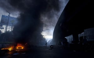 bangkok violence: The barricades continue to burn as dusk falls