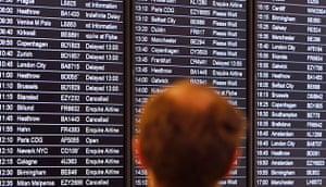 Volcanic ash: Man views an airline departures board Edinburgh airport