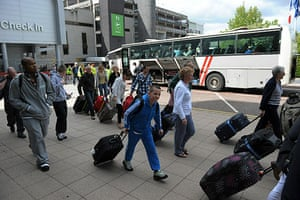 Volcanic ash: Passengers board buses at Manchester Airport, after the airport was closed