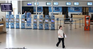 Volcanic ash: A woman walk in a deserted Belfast City Airport, Northern Ireland
