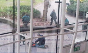 Police arresting a man at Liverpool John Moores University after a series of anti-terror raids