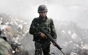 protests in Thailand: A soldier during an operation to evict anti-government protesters