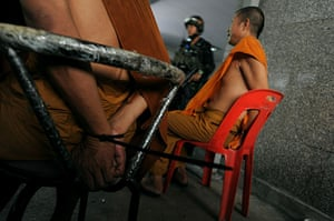 protests in Thailand: Buddhist monks are detained by soldiers inside the red shirt camp