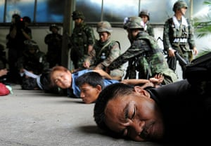 protests in Thailand: Red Shirt anti-government protestors are detained by soldiers