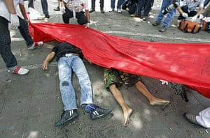 protests in Thailand: A red banner is lowered over the bodies of two protesters
