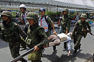 Bangkok protests: An injured journalist is carried to an ambulance