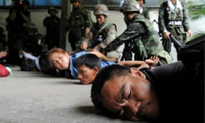Redshirts are detained by soldiers inside their camp in Bangkok, Thailand
