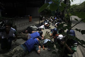 Bangkok crackdown: Journalists take cover during a gun battle