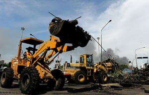 Bangkok crackdown: Civic authorities use front loaders