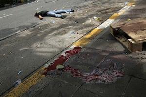 Bangkok crackdown: The body of an anti-government protester