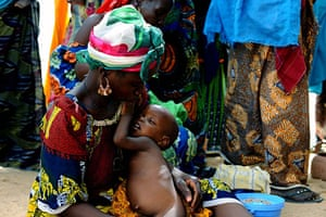 Niger Children: Saratou holding her son Badamassi, 18 months, as they wait to be weighed