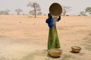Niger Children: Faiza, 25, preparing seeds to plant in hope of a better harvest this year