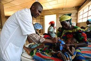 Niger Children: Nurse Ali helps Mariama feed her daughter Salaha therapeutic milk