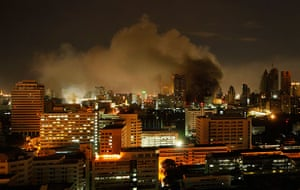 red shirt protesters: Smoke rises from burning fires in downtown Bangkok