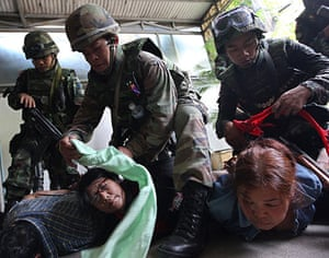 red shirt protesters: Soldiers arrest protesters during a crackdown