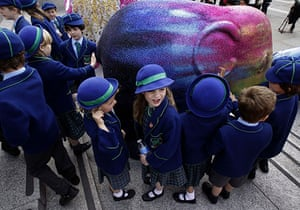 Global animal sculptures: School children inspect at an elephant in Traflagar Square