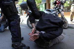 May Day protests: Athens, Greece: A policeman detains a demonstrator