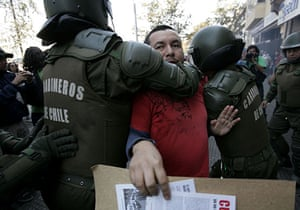 May Day protests: Santiago, Chile: A demonstrator is arrested by riot police