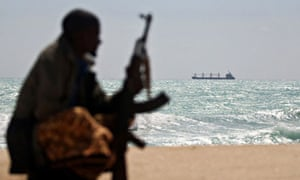 An armed Somali pirate on the shores of Hobyo