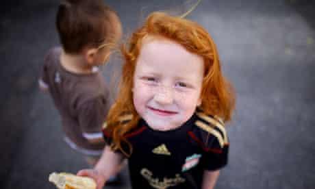 red haired girl eating bread children